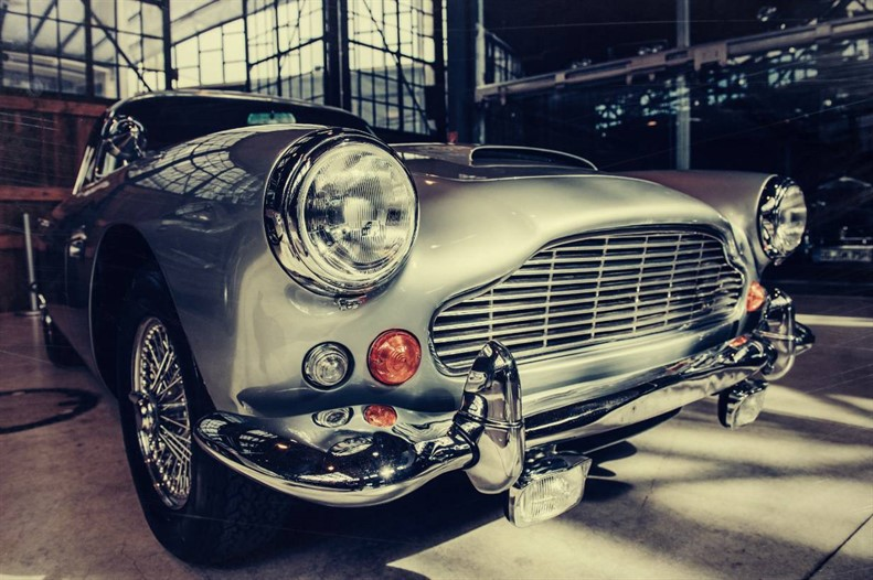 Close up of a silver Aston Martin DB5