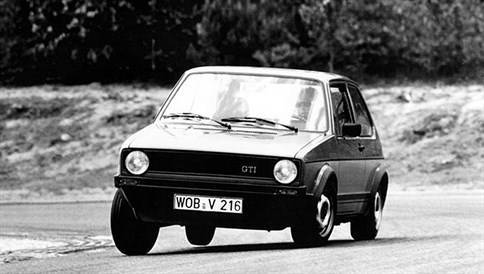 MK1 Golf GTI classic car taking a corner on a track at speed