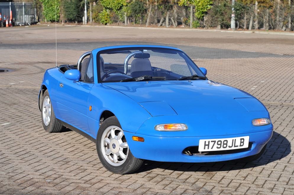 The Lancaster Insurance Eunos MX5 with its roof down in a car park