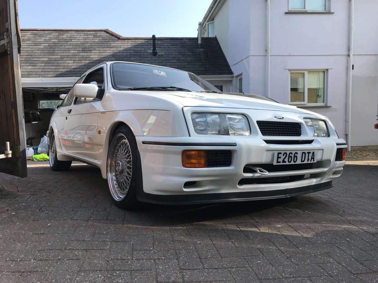 Ford -Sierra -RS500-Cosworth parked outside house side on