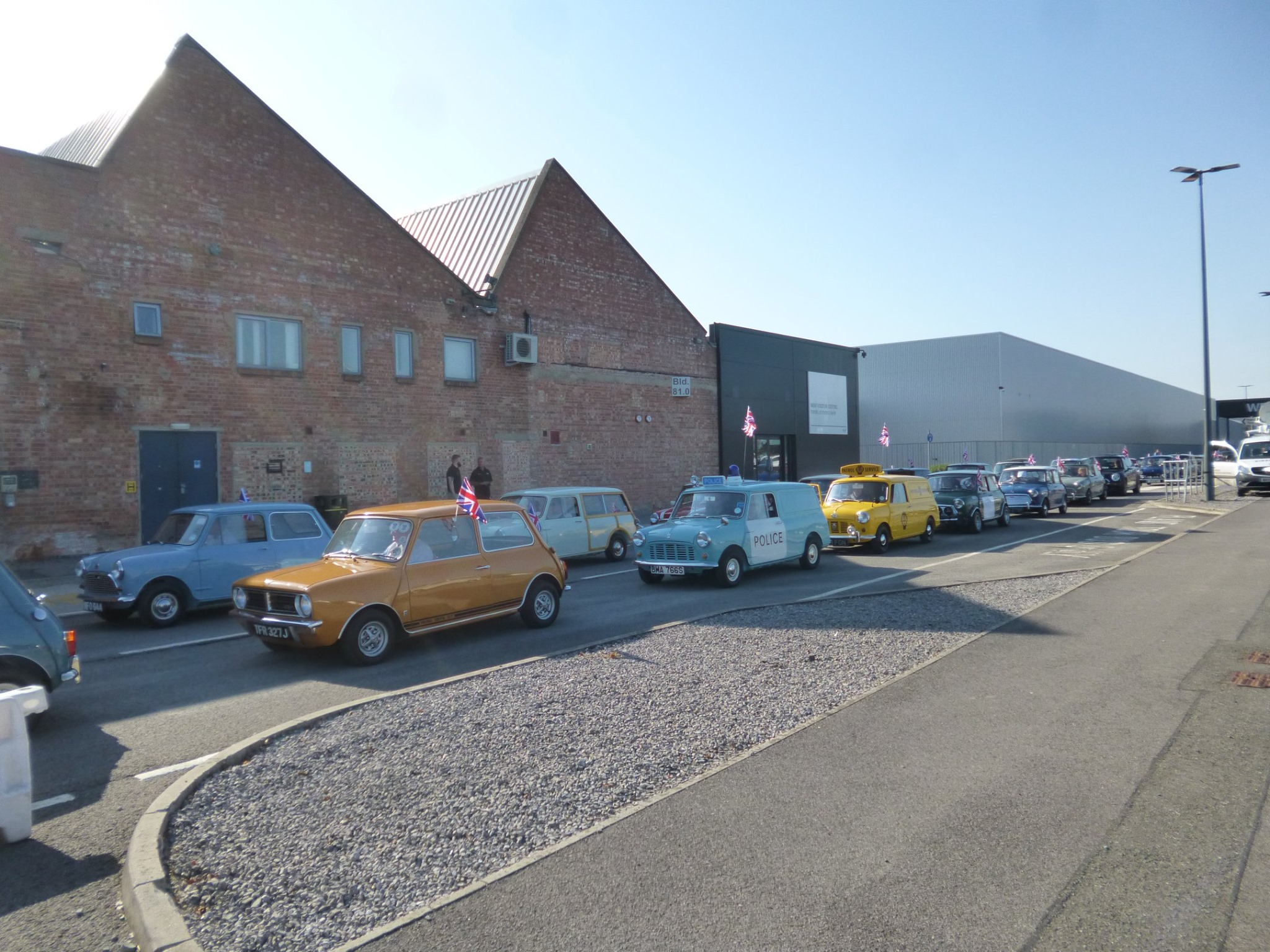 The Cavalcade leaving the factory with many minis of varying style