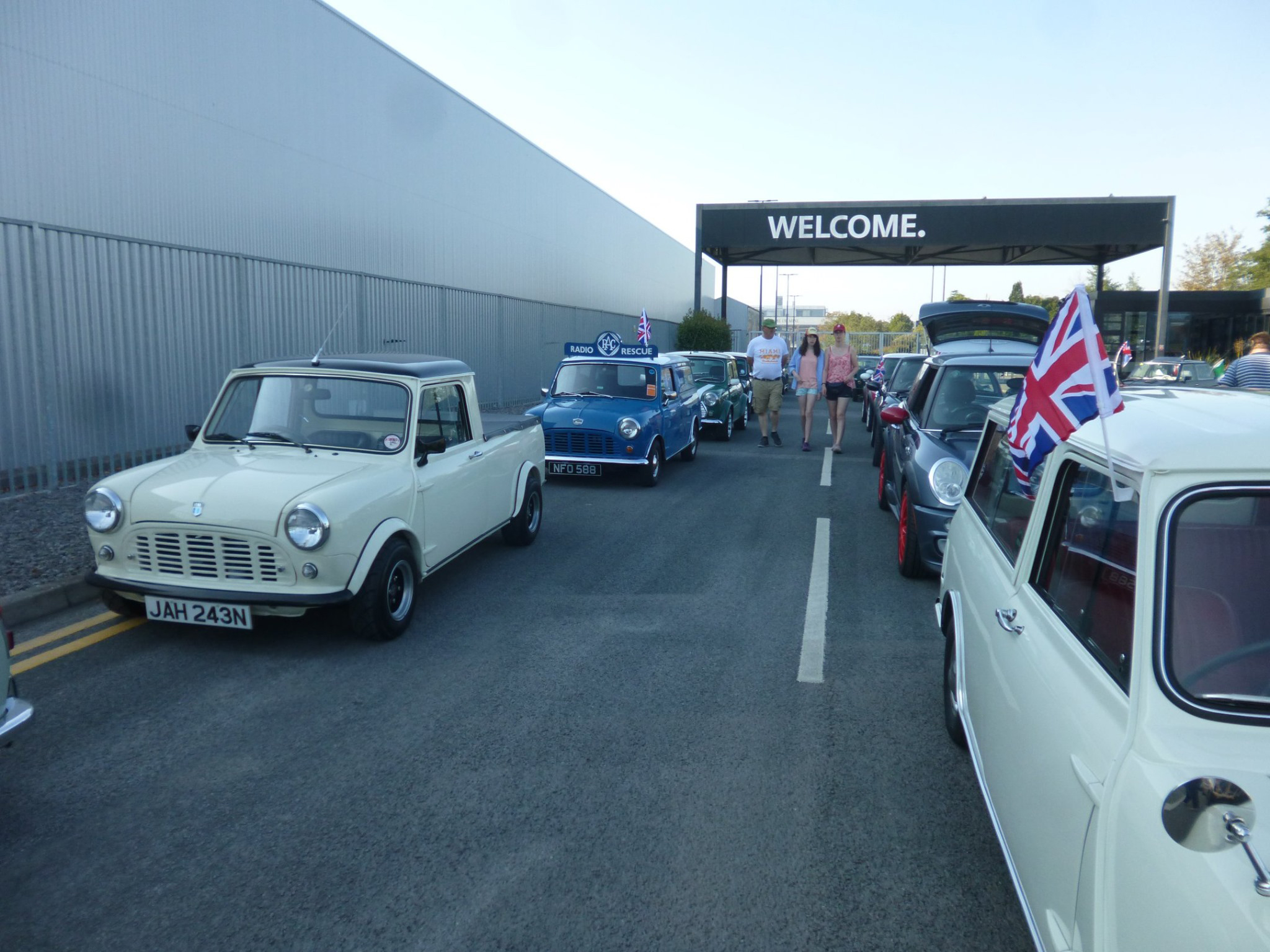 A view in between the Cavalcade with a white pick up style of the mini visible