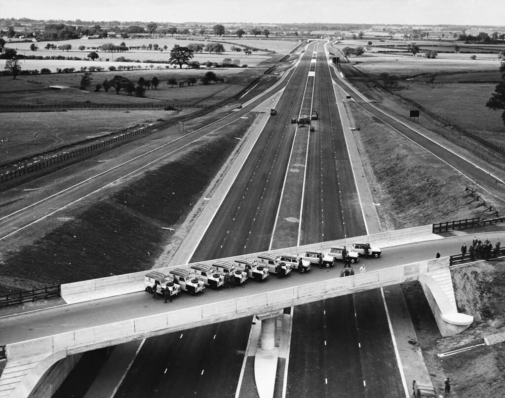 A picture over a bridge on the M1 lined with cars on the opening day