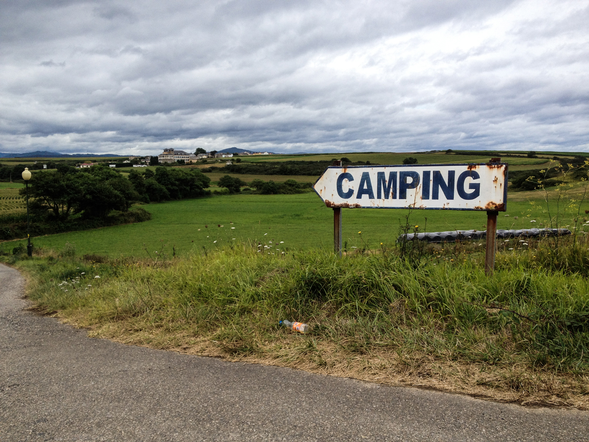 A sign on a corner of a field reading Campsite