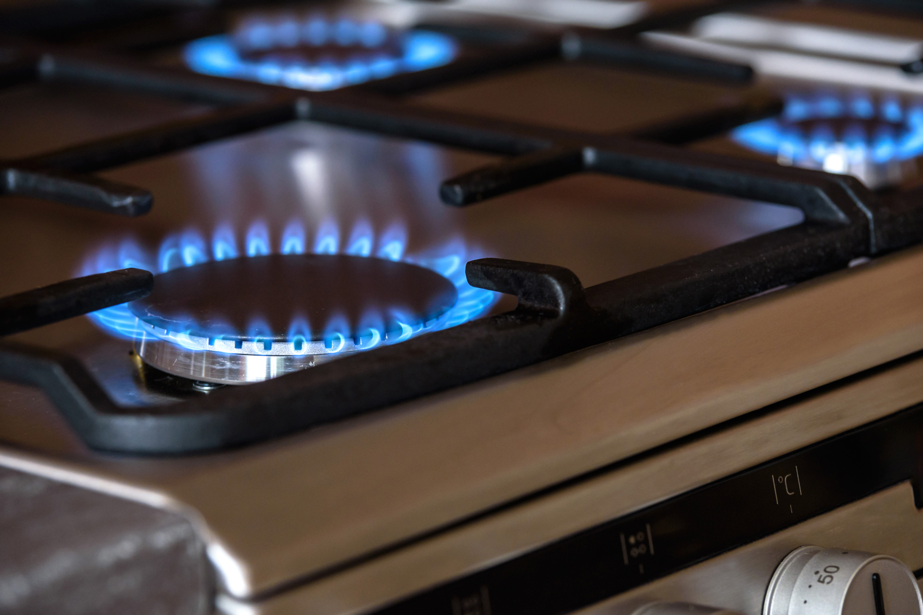A lit gas hob in a motorhome kitchen