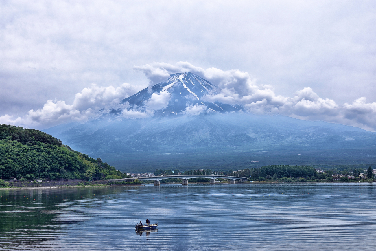 A scenic view across a lake in Japan with Mt. Fuji in the distance