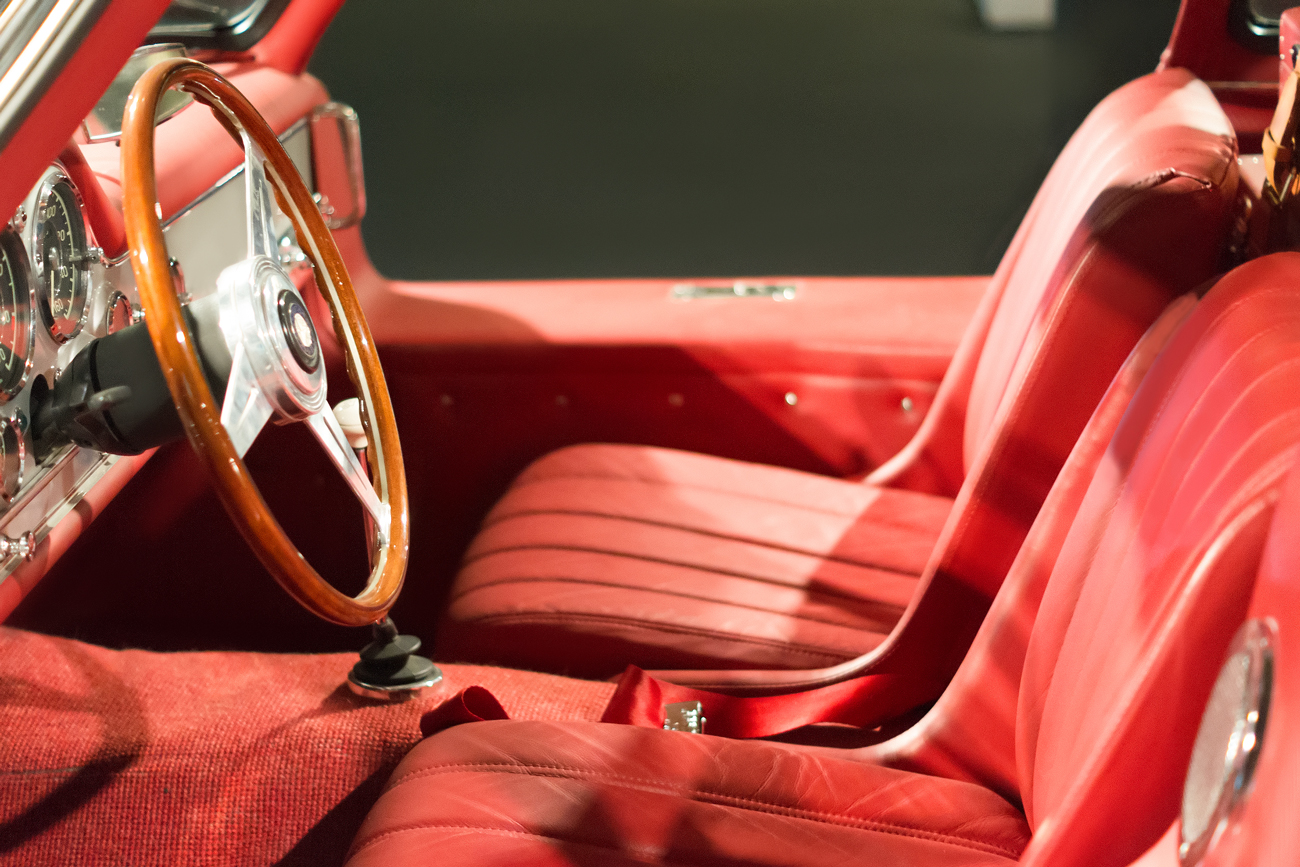 A red leather interior of a convertible classic car