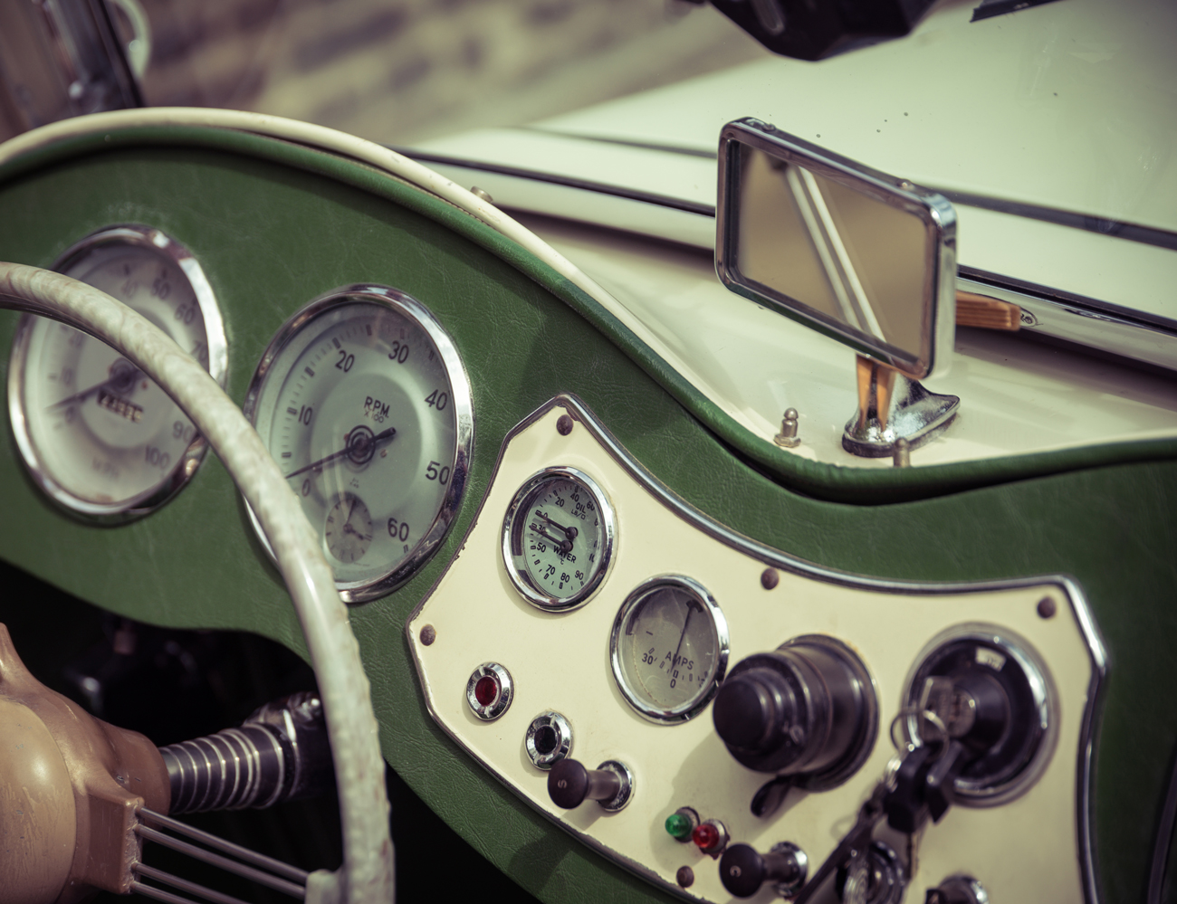 The dashboard of a vintage classic car