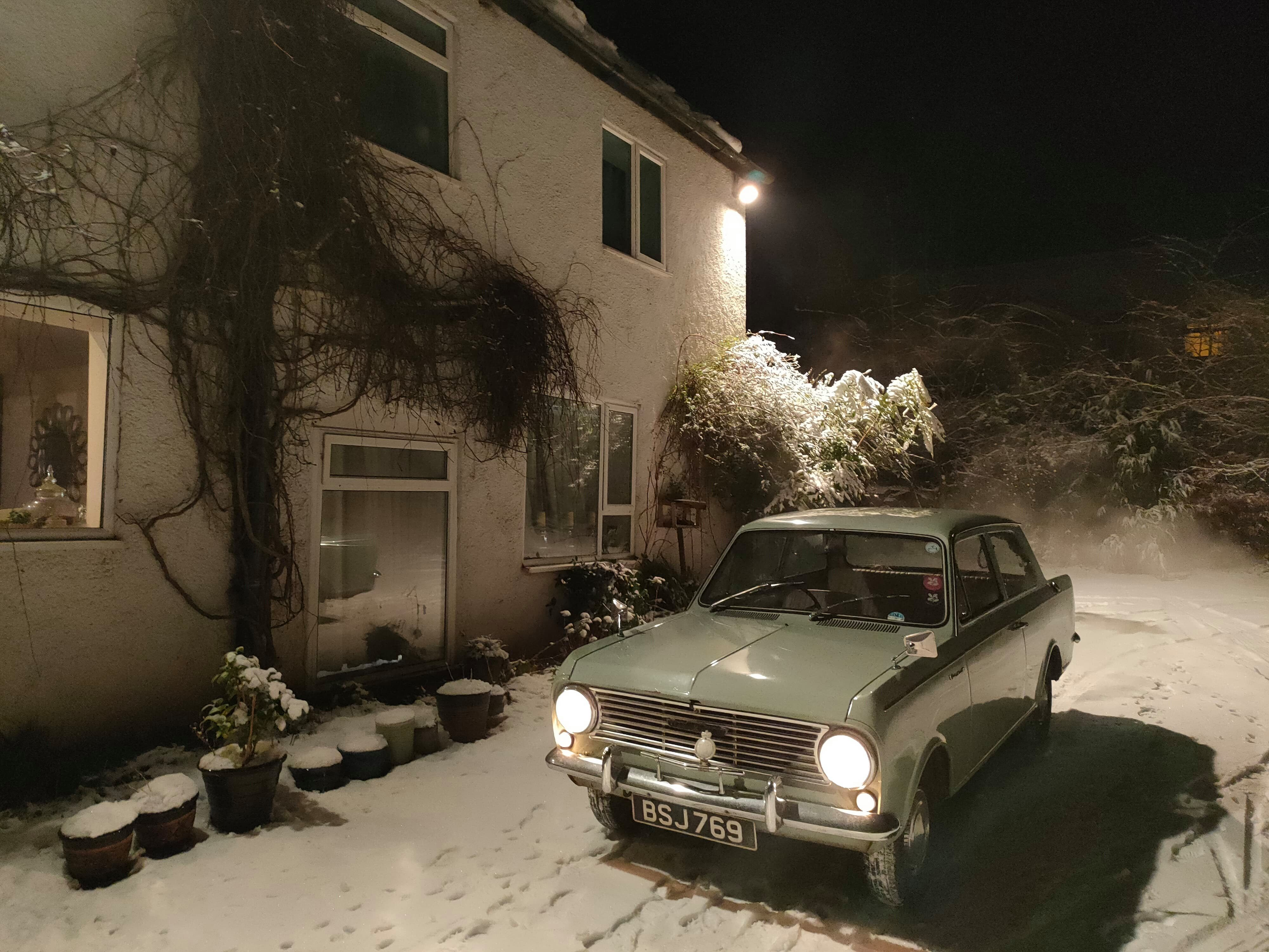 Snowy car and house