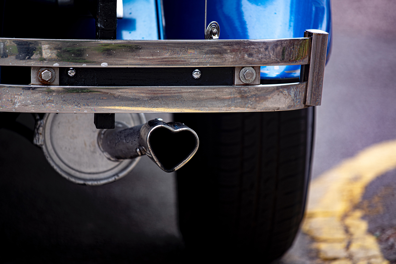 A classic car with a heart shaped exhaust tip